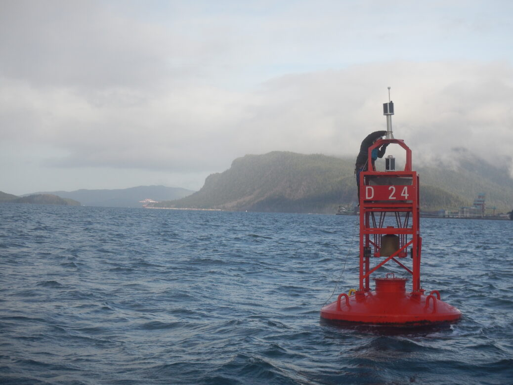MarineLabs Director of Product, Dr. Majid Soleimani-nia installs a CoastScout instrument to D24 AtoN in Prince Rupert, BC